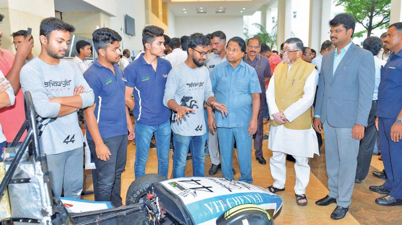Union minister of state for labour and employment,  Santosh Kumar Gangwar, looks at project exhibits designed by students after inaugurating technoVIT'19, at VIT Chennai on Thursday. Dr G.Viswanathan, Founder and Chancellor of VIT and Mr. G.V.Selvam, Vice President, VIT also seen.  (Photo: DC)