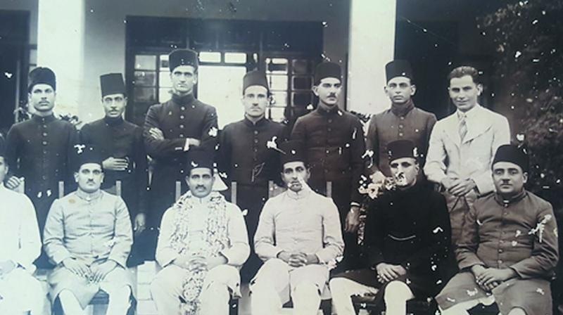 The writer's father (standing third from left) who joined the Hyderabad Revenue Service in the early 1930s had to perforce wear a sherwani and fez for all official functions. (Photo: File photo)