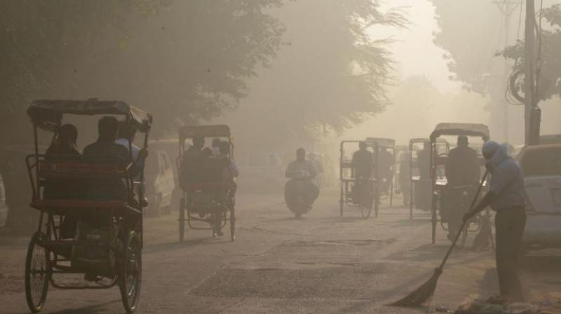 "Delhiites woke up to a thick blanket of smog as pollution levels hit ""severe"" category on Tuesday. (Photo: AFP)"
