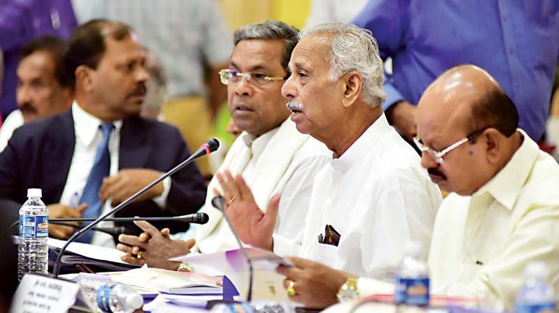 Chief Minister Siddaramaiah and ministers Kagodu Thimmappa and T.B. Jayachandra at top bureaucrats' meeting in Bengaluru on Tuesday. (Photo: KPN)
