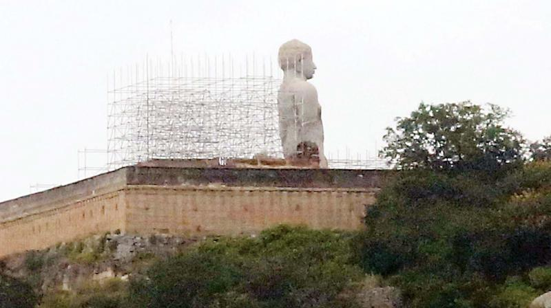 Scaffolding erected behind the statue of Bhahubali at Shravanabelagola for Mahamastakabhisheka. (Photo: DC)