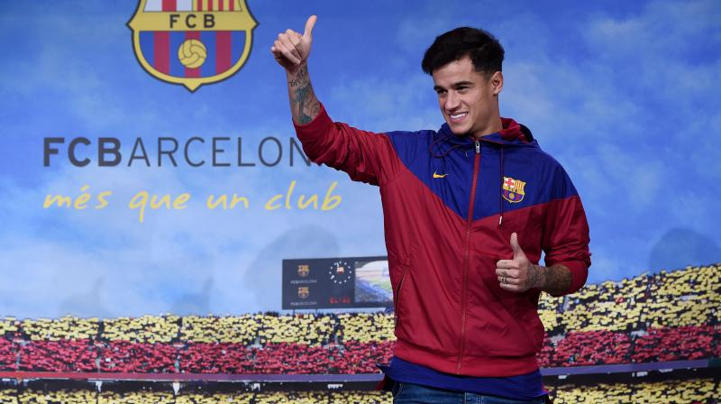 : Philippe Coutinho officially signed with Barcelona on Monday but the club said his debut will be delayed by about three weeks because of a muscle injury.(Photo: AFP)