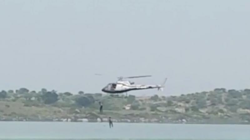 Kannada actors jumping from chopper in Thippagondanahalli Reservoir during shoot. (Photo: video grab)