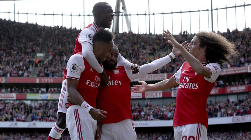 Pierre-Emerick Aubameyang says Arsenal could try to fight fire with fire on Saturday by deploying him in a front three alongside Alexandre Lacazette and Nicolas Pepe when they travel to face Liverpool's attacking trio of Mohamed Salah, Sadio Mane and Roberto Firmino combined for 69 goals and 19 assists in all competitions last season and Pierre-Emerick Aubameyang labelled them 'one of the best trios in the world'. (Photo:AP)