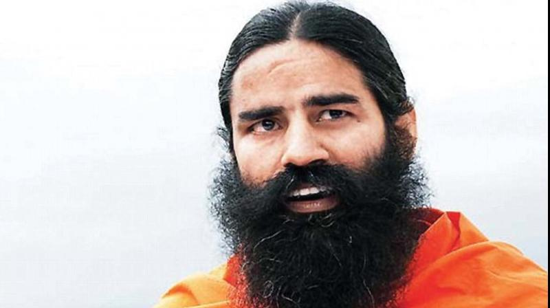 Ramdev was to perform yogic kriyas at the event along with thousands of enthusiasts, including Bollywood celebrities, to mark the occasion which would have been the first of its kind to be held on the banks of the Ganga. (Photo: File)