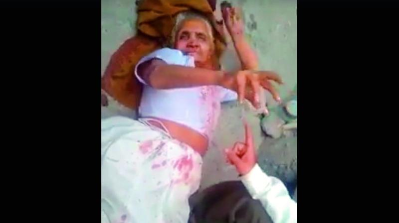 Rajindari Devi lying on the ground after her son had beaten her up
