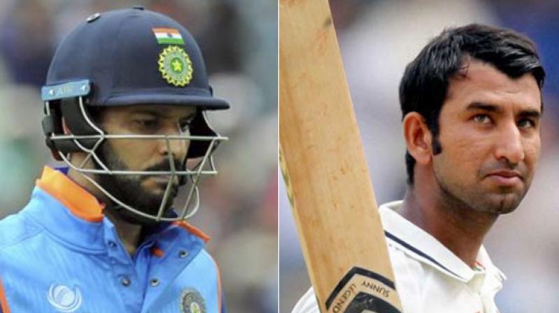 Yuvraj Singh and Cheteshwar Pujara. (Photo: AP / PTI)