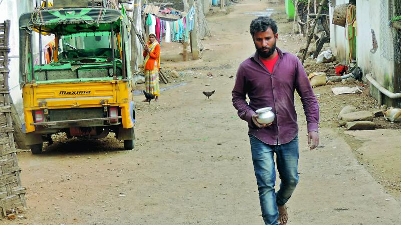 Accused Sheik Shaboddin's brother Sheik Sharfoddin with the silver bowl given by the rape victim just before she was raped and murdered in the Yellapatar village in Lingapur mandal in Kumarambheem Asifabad district, on Monday. (Photo: Pillalamarri Srinivas)