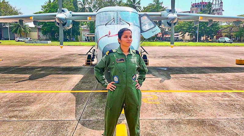 Sub-lieutenant Shivangi stands in front of the Dornier surveillance aircraft. (Photo: AP)