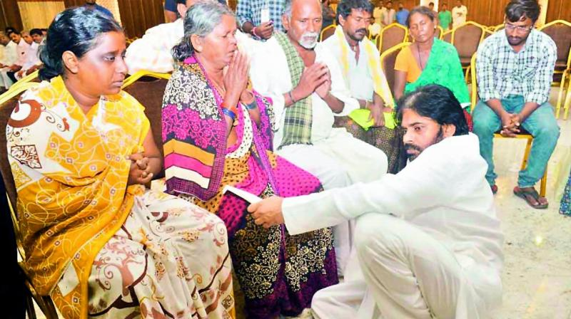 Jana Sena chief Pawan Kalyan visits the family members of deceased at Anantapur who were killed in road mishap in Kurnool district. — DC
