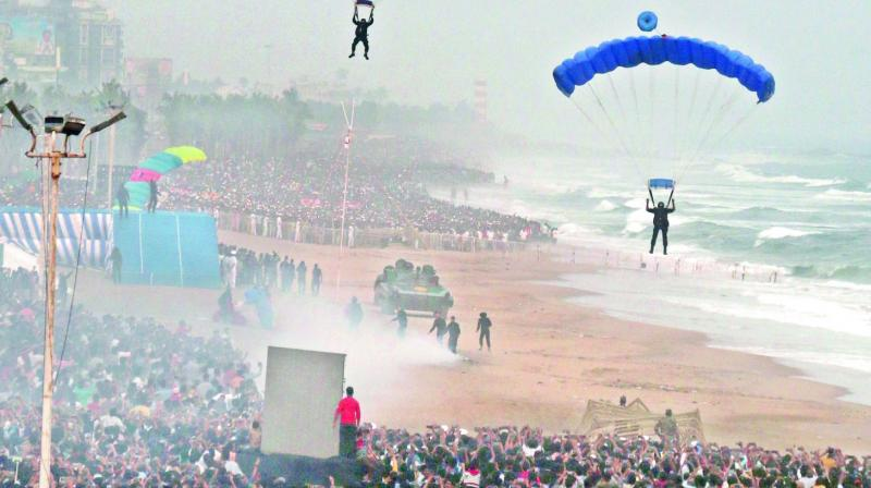 Marine commandos demonstrate on safe landing from parachutes during the Indian Navy Operational Demonstration at the Navy Day celebrations at Ramakrishna Beach in Vizag on Tuesday.