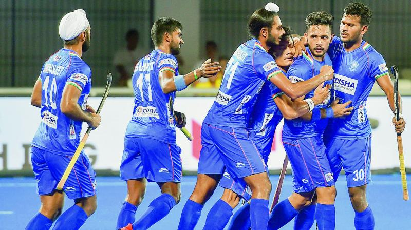Indian players celebrate a goal against Japan during the semifinal of FIH Men's Series Finals at Kalinga Stadium in Bhubaneswar on Friday. (Photo: PTI)