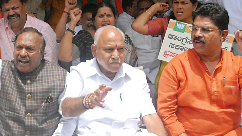 BJP leaders K.S. Eshwarappa, B.S. Yeddyurappa and R. Ashok protest in Bengaluru on Friday against the sale of land to the Jindal group at a throwaway price in Ballari