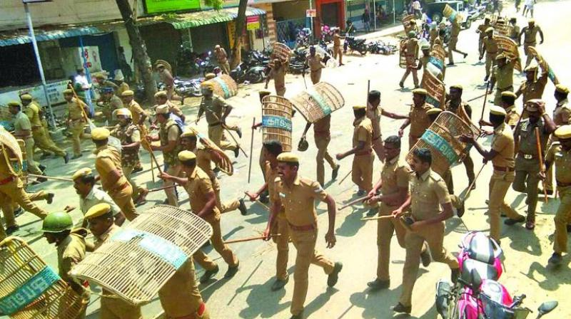 Security personnel opened fire at protesters in Anna Nagar on Wednesday