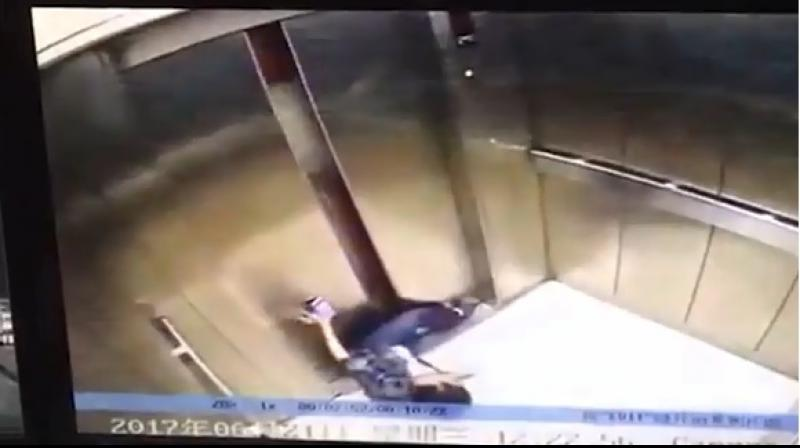 A woman in China has allegedly had her leg severed by a faulty lift after getting it trapped between the closing doors. (Photo: Youtube Screengrab)