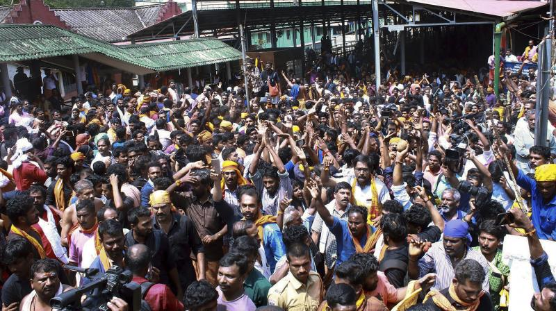 Devotees protest as several female devotee arrive to offer prayers at Sabarimala temple on Sunday. (Photo: PTI)