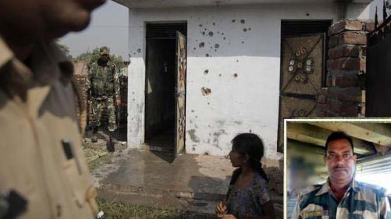 Indian security personnel inspect a house damaged allegedly from firing from the Pakistan side of the border, at a residential area near the international border at Bidipur, in Ranbir Singh Pura, about 35 Kilometers from Jammu. (Photo: PTI)