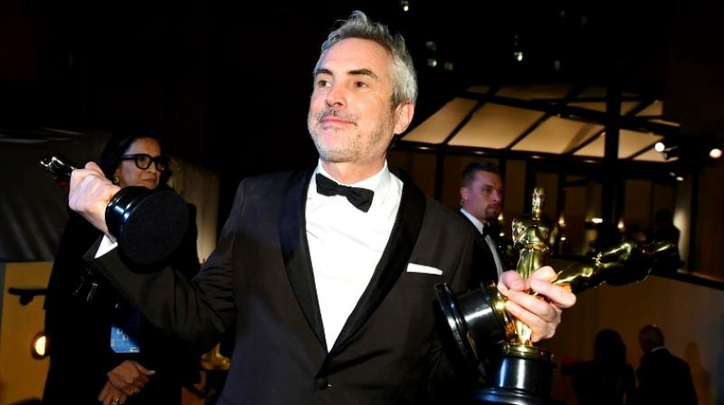 "Alfonso Cuaron received three Oscars in 2019 for ""Roma,"" a Netflix movie. (Photo: AFP)"