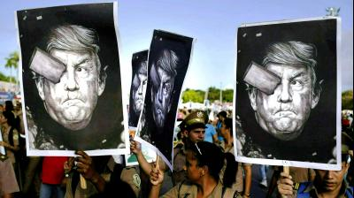 Cuban soldiers carry depictions of President Donald Trump during the annual May Day parade held at Revolution Square in Havana, Cuba. Trump claimed via Twitter that if Cuban troops and militia do not cease their operations in support of Venezuela immediately, Cuba would suffer