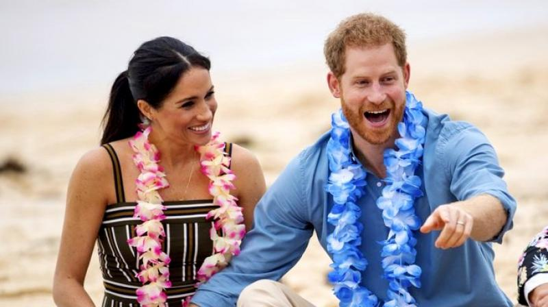 Britain's Prince Harry and Meghan, Duchess of Sussex meet with a local surfing community group, known as OneWave, raising awareness for mental health and well-being at Bondi Beach in Sydney. (Photo: AP)