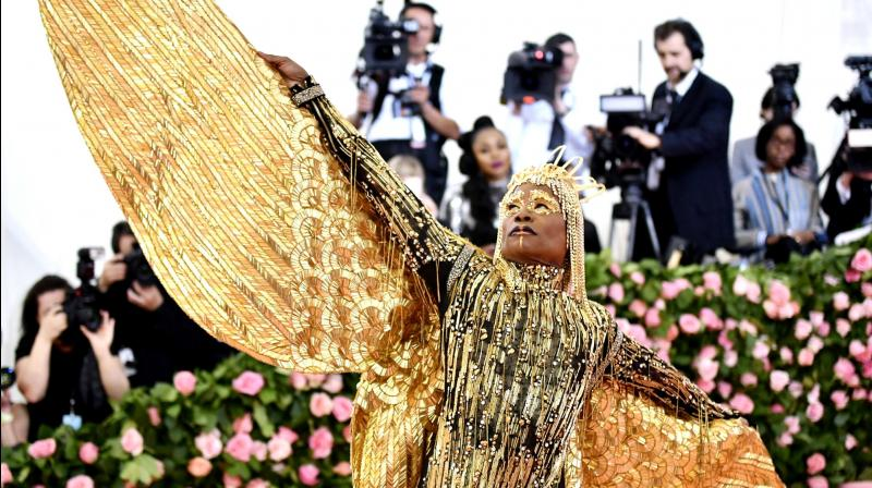 Enveloped in gold, Billy Porter attended The Metropolitan Museum of Art's Costume Institute benefit gala dressed as Egyptian sun deity. (Photo: AP)