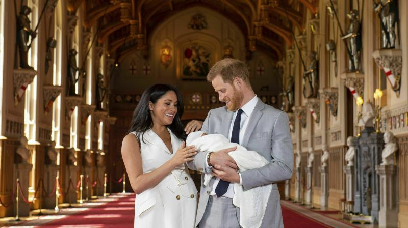 Britain's Prince Harry and Meghan, Duchess of Sussex, during a photocall with their newborn son, in St George's Hall at Windsor Castle, Windsor, south England. (Photo: AP)