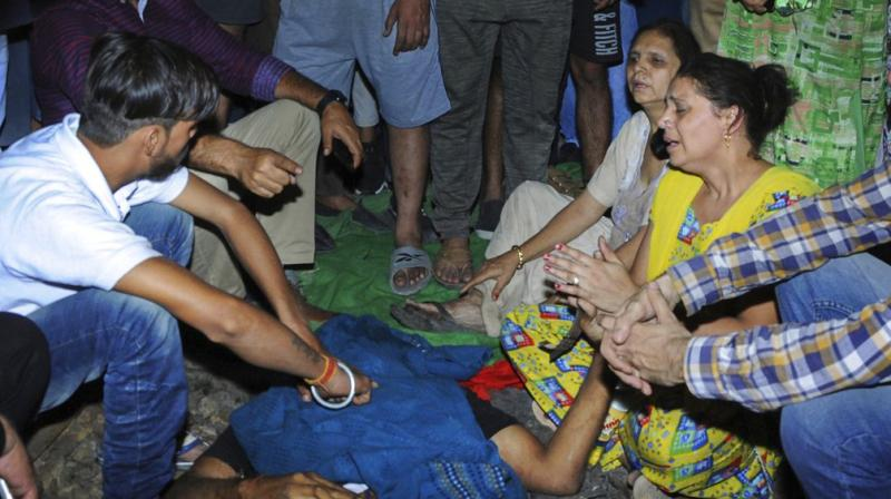 At least 50 killed after train ploughs into crowd in India