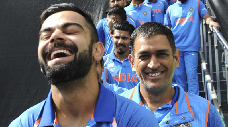 The leadership transition from MS Dhoni to Virat Kohli has been a smooth ride as the two continue to share a heartwarming relation with each other. (Photo: AP)
