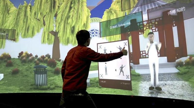 "Rensselaer Polytechnic Institute graduate student Xiangyang Mou practices tai chi with an avatar in a campus studio at Rensselaer Polytechnic Institute in Troy, NY. The ""Mandarin Project"" is a joint venture of RPI and IBM. (AP Photo/Michael Hill)"