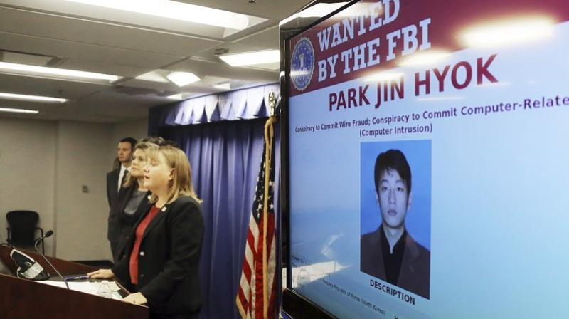 United States Attorney Tracy Wilkison announces a criminal complaint being filed against a North Korean national accused in a series of destructive cyberattacks around the world, at a news conference in Los. The complaint alleges Park Jin Hyok, computer programmer accused of working at the behest of the North Korean government, was charged Thursday in connection with several high-profile cyberattacks, including the Sony Pictures Entertainment hack and the WannaCry ransomware virus that affected hundreds of thousands of computers worldwide. (AP Photo/Reed Saxon)