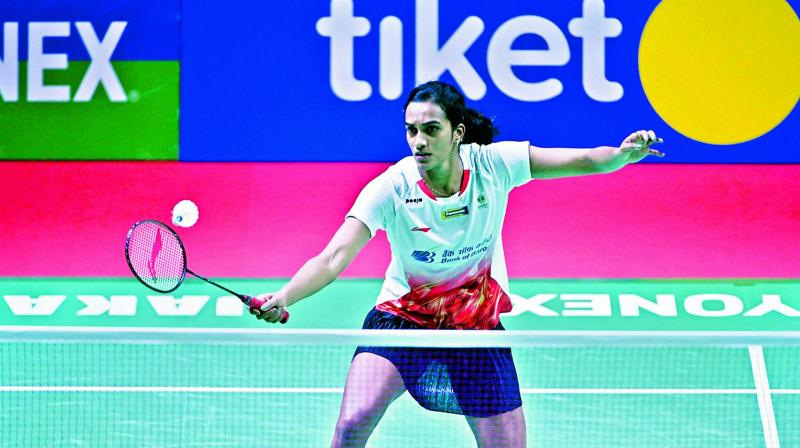 P.V. Sindhu en route to her 21-14, 17-21, 21-11 win over Mia Blichfeldt of Denmark in their second round match at the Indonesia Open in Jakarta on Thursday.  (AFP)
