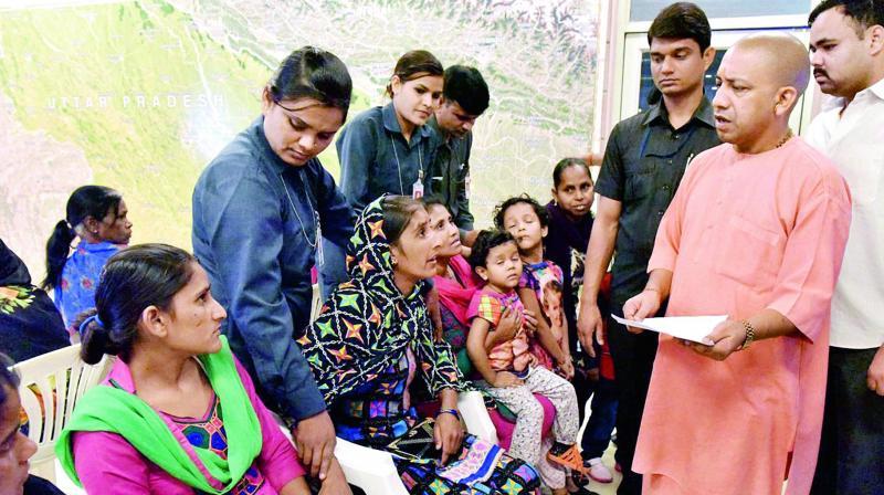 Uttar Pradesh Chief Minister Yogi Adityanath listening to problems of people during his Janata Darbar in Lucknow on Wednesday. (Photo: PTI)