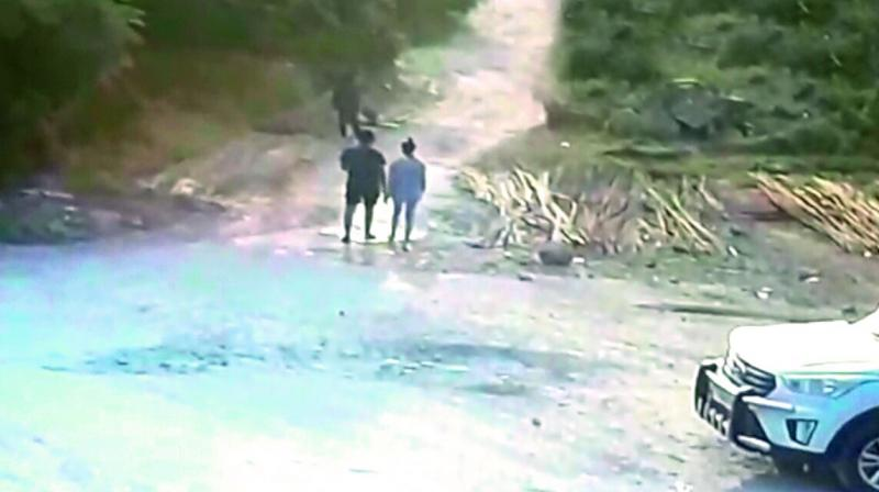 A CCTV screengrab, which was captured near the spot where Chandini's body was found, shows her walking with an unidentified boy. (Photo:DC)
