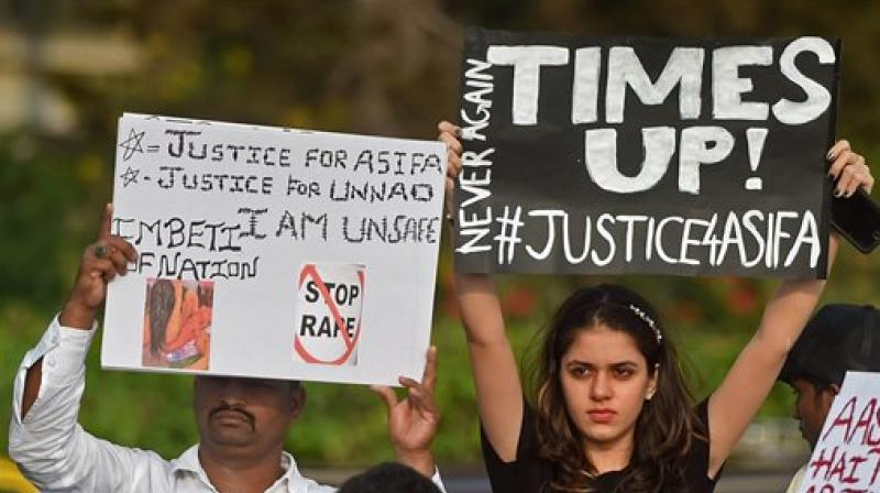 People take part in a protest demanding justice for the victims of Kathua and Unnao rape cases, in Mumbai on Sunday. (Photo: PTI)