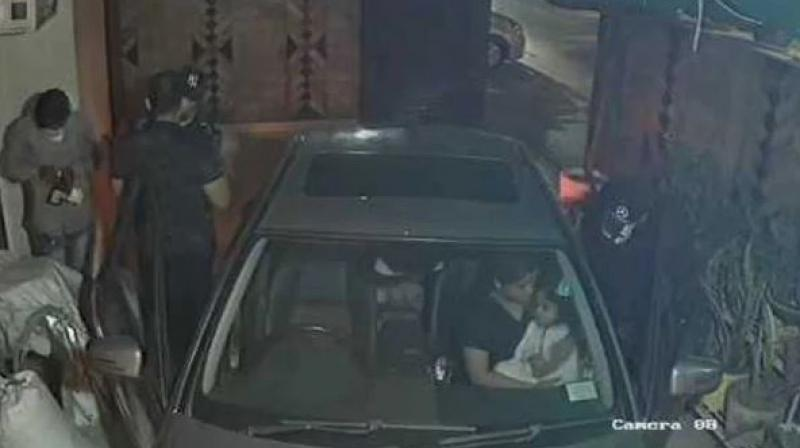 In the video, Bahl was seen stepping out of his Mercedes and running to close the gate when the three men barge inside, pointing a gun at him. (Photo: Screengrab)