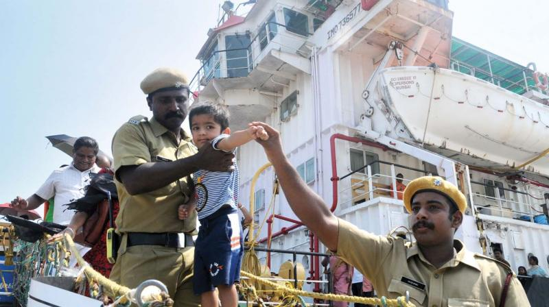 A child is curious while entering a dredging ship anchored near Samudrika Hall. Public were allowed to visit the ship on account of 92nd Port Trust day celebrations on Tuesday. (Photo: DC)