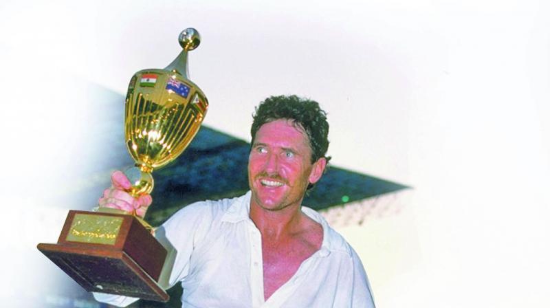 Australia skipper Allan Border celebrates, holding the 1987 World Cup.