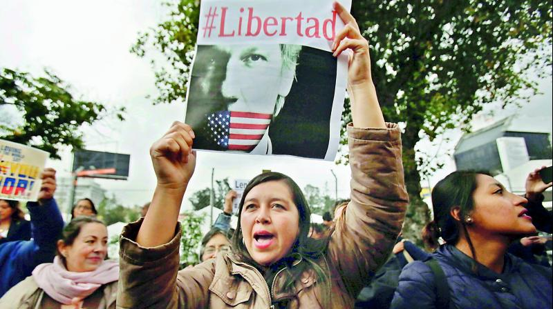 A woman holds up the Spanish hashtag #Freedom during a protest against the arrest of WikiLeaks founder Julian Assange, outside the Foreign Ministry in Quito, Ecuador.