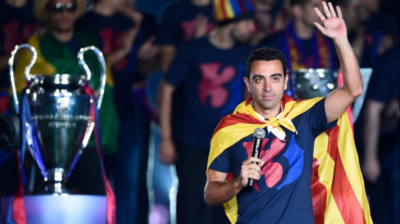 Xavi further confirmed his intention to follow in the footsteps of Dutch footballer and coach Johan Cruyff. (Photo: AFP)