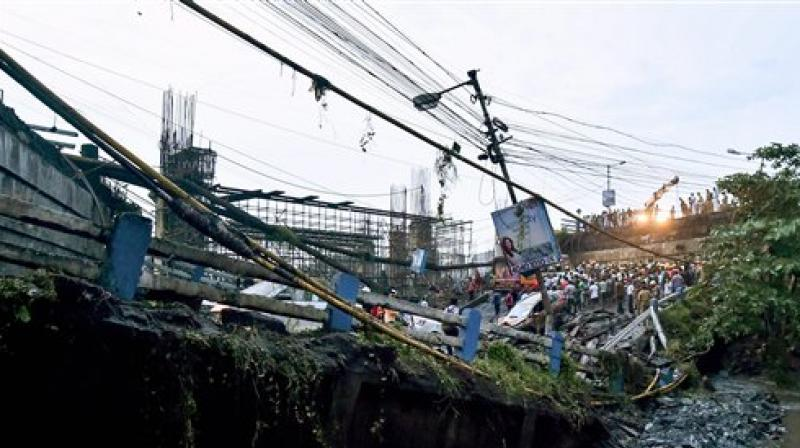 A section of Majerhat bridge collapsed in Kolkata on Tuesday. According to the police, a portion of the bridge collapsed this evening, claiming one life, trapping several people and crushing many vehicles. (Photo: PTI)