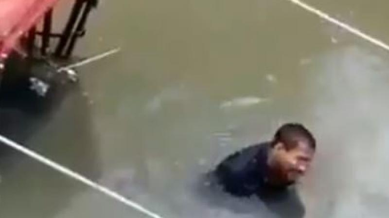 However, one particular video from Patna has gone viral which showed a rickshaw puller stranded in chest-deep water. (Photo: Screengrab)