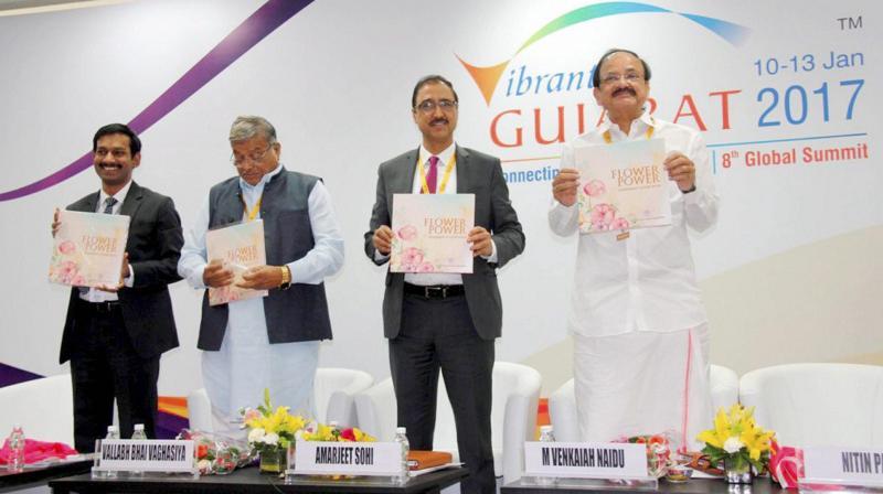 Union I & B Minister M Venkaiah Naidu releases a publication during the Vibrant Gujarat Global Summit 2017 at Mahatma Mandir in Gandhinagar, Gujarat. (Photo: PTI)