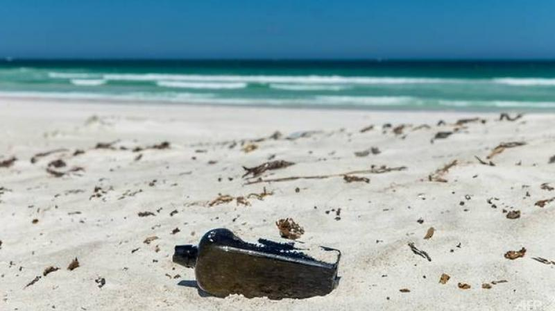 It took weeks of sleuthing using Google Translate, online research and archival digging before the unusual find was confirmed as an authentic bottle thrown from a German ship into the Indian Ocean. (Photo: AFP)
