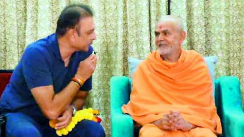 Team India coach Ravi Shastri seeking the blessings of spiritual guru, Bapa Mahant Swami