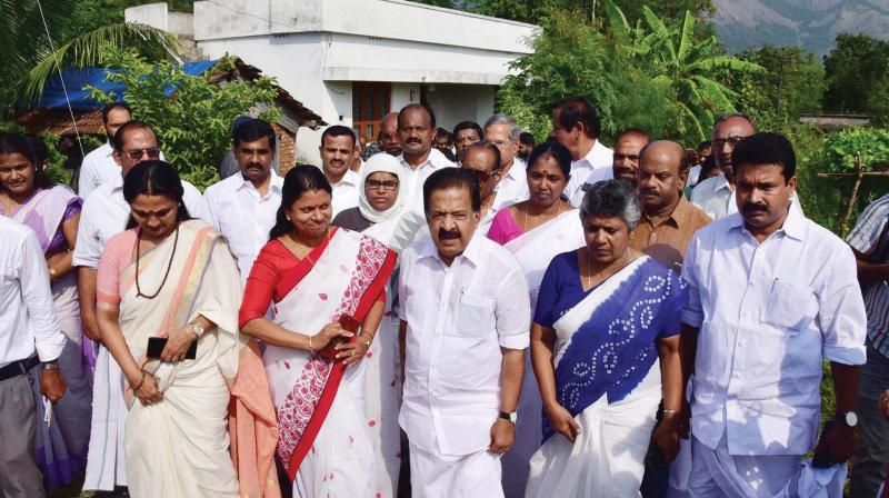 Opposition leader Ramesh Chennithala at Attappallam in Walayar on Friday after meeting the parents of the minor sisters