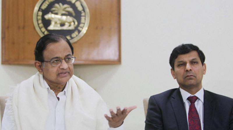 The Centre said it will take action against the people, hinting at former RBI governor Raghuram Rajan (R) and ex-finance minister P Chidambaram (L) at the time who relaxed gold import norms for private trading houses during the dying days of the UPA regime which resulted in a windfall of Rs 4,500 crore to 13 such entities in just six months. (Photo: PTI)
