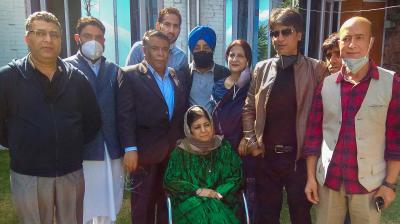 Former Chief Minister of Jammu and Kashmir and President of Peoples Democratic Party (PDP) Mehbooba Mufti poses for a photograph with senior party leaders, at her residence in Srinagar, Wednesday, Oct. 14, 2020. Union Territory administration revoked the Public Safety Act charges against Mufti, more than a year after she was detained following the abrogation of the special status of the erstwhile state. (PTI)