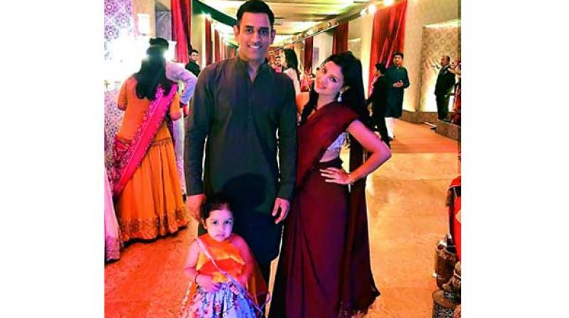 M.S. Dhoni with Sakshi and Ziva