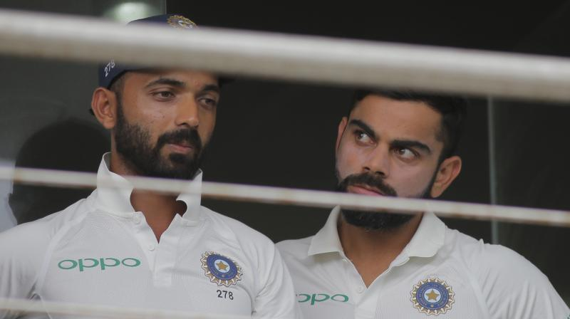 India captain Virat Kohli on Friday took a dig at critics questioning Ajinkya Rahane's exclusion in the first Test against South Africa, stating that those who wanted his deputy's omission are now clamouring for his comeback.(Photo: AP)