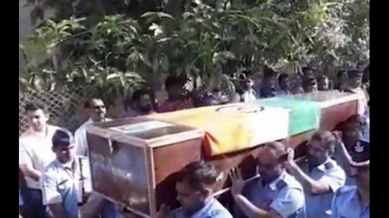 The funeral of pilot Ninad Mandavgane, who died in an IAF helicopter crash in Jammu and Kashmir two days back, was held with full military honours in Nashik on Friday. (Photo: Twitter/ @currenttrendng)